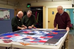 disaster-relief-quilting-our-savior-lutheran-church-men-tying-quilt